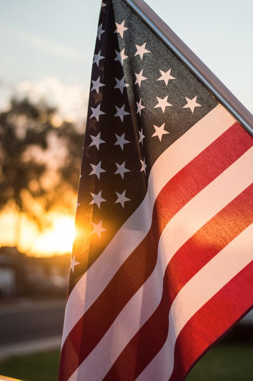 american flag with sun setting behind.jpg
